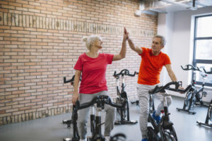 Couple Exercising Through Phsyiotherapy