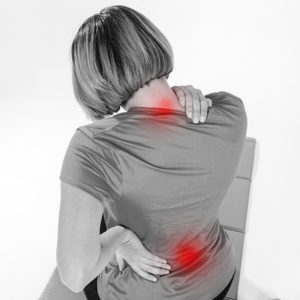 Woman with back pain-physiotherapy