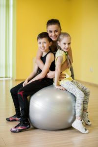 Women and Kids In Physical Therapy Class